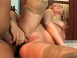 This blonde cougar gets with her boy toy in the living room.  They exchange oral and fuck in several positions, pausing so this slut can taste her pussy juice on her boy's cock.  In the end, she takes his load in her mouth and lets it dribble down onto her tits.