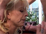In this scene, a blonde cougar gets it on with a guy in the sun room.  She sucks cock, and then opens up her asshole for a pounding.  This anal whore takes it deep in her bowels and sucks her juices off that cock until getting a load of goo in her mouth.