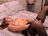 Antonia is the starring slut for this solo scene.  She peels herself out of her lingerie and gets on the bed with a big dildo.  Stuffing it in and out of her pink pussy gets her dripping wet, and she creams all over it.  Her hole spews her cream when she pulls the toy out of her used hole.