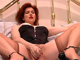 This redhead is seriously hard to please. She starts by getting into her naughtiest lingerie, then she fingers her pussy and plays with her clit. She gets really freaky when she stuffs her own asshole with anal beads, then finger fucks herself some more. When that still doesn't do it for her, she