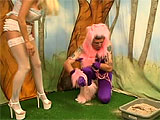 Alice in Wonderland got more than she asked for with this deranged Cheshire Cat. At first he's not interested in her, but when she offers him some toys, he gets excited. She disciplines this frisky guy with some paddling, then some light rope binding. When he's totally submissive to her, she giv
