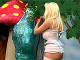 When this buxom Alice finds Wonderland's caterpillar, all she wants is to find her way home. But this stoner version of the insect isn't talking. He's too busy with his hookah, and forces sexy Alice to try some mushrooms too. She gets pissed and blows smoke back in his face. Then she gags him,