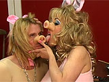 When two of the three little pigs are forced to move in with their bitchy, crazy, but sexy mother, they disappoint her constantly. She's loud and bossy, forcing them to scrub the floors and be obedient. When they're not, she spanks and paddles them and chains them to the wall. Her massive tits a