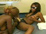 A couple of hot ebony ladies get it on in with each other in this scene. They start by feeling each other up and licking some pussy.  Then, they use  a strap on to fuck their juicy, wet twats.
