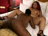 A couple of chunky ebony ladies get it on in this scene.  They start by sucking on each other's big round tits, prior to tonguing and toy fucking their juicy, wet twats.