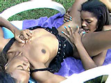These two black chicks are out in the grass for their playtime.  They are discussing different things they like and how they like their sex, and then they get to it.  They eat each others pussies and get each other off.