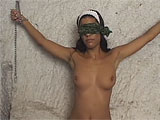 For this scene, a sexy Latina is blindfolded and chained to the wall.  Two studs come in and start spitting their beer all over her and licking her all over.  They eat her pussy and get busy stuffing their dicks in her holes.  She takes them in her mouth, pussy, and tight little asshole.  This littl