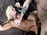 This big tit blonde is playing with a dildo and shoving it in her bald pussy until a guy comes in.  She sucks his cock deep in her throat and then fucks him silly.  Would you expect anything less from a girl that wears a choker with the word whore?  She takes an open mouth facial, plays with the cum