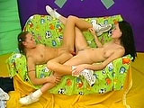 In this scene, Jenny and Tracey are a couple of young chicks that have some fun together on the couch.  Watch as these two explore their bodies, lick pussy, and use all sorts of toys as they experiment and play.  They end with a hot anal beaded scissor fuck.  When they are done on the couch, they go