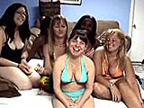 This amateur scene has a group of six women on a bed.  Vixen, Tiger, Lulu, Liisa, Lucky, and Charm all get undressed to play with boobs and lick pussy.