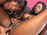 Candace Von and Nyomi Banxxx are two Nubian sluts that are having some fun with each other.  They 69 so they can taste each other, and then they work a double ended dildo in between them to reach orgasm.  Nyomi dons a strap on and fucks Candace in a few positions.