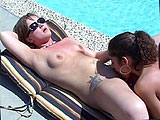 Cassidy Essence is topless in the pool while Amina Sky watches from the chaise.  Cassidy convinces Amina to get in the water, and then gets her out of her bikini top.  This turns on Amina and she gets frisky with her friend.  They kiss and then she has Cassidy lay back at the edge of the pool so she