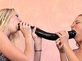 Aaliyah Jolie brings a giant double ended dildo in to the room for her and Frankie Vargas to play with.  They can barely get their mouths around it, so they get out a more reasonable sized dildo for Frankie.  Aaliyah continues to play with the monster and stuffs it in her cunt, while Frankie uses th