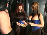 In this first scene, watch Mistress Summers giver her submissive a good old fashioned domination session.  She spanks and paddles his wussy ass, and then goes to work on his junk.  Watch her play with his Prince Albert piercing and load up his ball sack with lots of clamps.  Next comes the candle wa