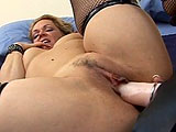 In this masturbation scene, Kelly Leigh uses a strap on by herself.  She shoves it in and out of her box while rubbing her clit.  She sucks her pussy juice from the dildo a few times in route to getting her self off.