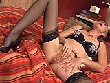 This older chick is Tai Ellis, and likes to get dressed up in lingerie when she masturbates.  She pulls her panties off and rubs her twat to get the juices flowing, and then shoves a vibrator in and out of her fuck hole.   She alternates between using her hands and the vibrator to bring herself to m