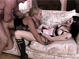 Cynara Fox and Joelean are dressed in slutty leather lingerie across the room from each other, turning each other on.  They get together on the couch and are then joined by a stud.  Pussy is eaten by all, and cock is sucked.  These three fuck in a few positions until the guy sprays their tongues wit