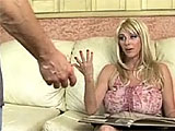 Penny Porsche is hanging out on the couch when a guy comes in to the room for poker night.  The game was moved to someone else's house, but Penny wants to do some poking herself.  They strip out of their clothes and Penny sucks on his dick.  She rides cowgirl and reverse, with her huge tits bounci