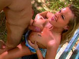 In this scene, Nina Ferrari is outside on a park bench with her man.  She gives him a blowjob and he fucks her big tits.  She then gets a licking and fingering in her neatly trimmed pussy.   He fucks her hard on the bench, and Nina strokes out his load on to her tits.