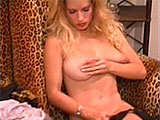 In this scene, Goldie tries on various lingerie and bra & panty sets.  She licks and sucks on her big tits throughout, putting on a nice tease.