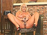 Kandi Cox shows off her huge FF's in this scene.  As if they needed anything to help draw attention to them, she has both of the nipples pierced to accent these huge sweater meat mountains.  Kandi pulls off her panties and works herself over with a vibrator until she is shaking in tune with the to