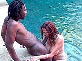Saki St. Jermaine is sucking a black guys big cock in the pool.  She takes it as deep as she can, but thats not very deep, considering the size of his cock.  She uses both hands to help stroke it.  In the end, she strokes it off into her mouth for a shot of his saki.