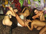 This scene has 3 slaves servicing their 2 mistresses.  It starts out with 2 of the slaves locked in cages while the third is used for pleasure.  The 2 are let out of their cages and all five get on the bed, where all sorts of licking, sucking, fucking, and toys are used.