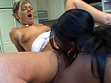 Two chicks are in the kitchen, and they find something tasty to eat; each other's pussies.   They lick each others twats and then scissor fuck on the kitchen island.  Some 69 action, a couple of glass dildos, and a rimjob round out the scene.