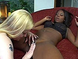 An ebony beauty and a white blonde chick get it on next to the fireplace.  After licking each others clits and some 69 pussy eating, things begin to heat up when the glass dildos are brought out.