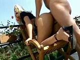 This scene features Debbie White.  She shows off her body and teases outside, playing with her bald pussy.  She sucks cock and then takes it from behind.  Debbie rides his cock and they fuck in a few other standard positions on the patio.  The guy gives her an open mouth facial with the sunlight sho