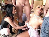 Alektra Blue has Holly Wellin as her slave toy.  She has her on a leash like a dog, smacking her with a riding crop and shoving a small butt plug and then a glass dildo in her tight little asshole.  Alektra leads Holly in to the house where two guys give her their bones.  She sucks their cocks deep