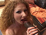 Dirty little redhead Annie Body starts this scene off right with a big black dick in her mouth.  She rides this dude's huge throbbing cock in a number of positions before taking a facial.