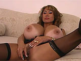 When you've got 54KK tits, like Minka does, they don't really make a bra big enough to contain those things.  This Asian works her tits with a vibe and then stuffs it in her hairy vag and creams all over it.