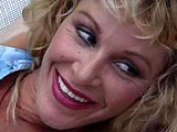 A super hot mom, Michelle St. James, shows off her fantastic body outside.  Next, her and a young guy go inside, so she can show this lucky stud a great time.