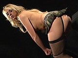 Kelly Wells does a little strip show at the beginning of this scene.  She rubs and fingers her shaved pussy, and then stuffs a big set of anal beads in her ass.  They are worked in and out of her asshole and this nasty slut sucks her juices from it.