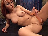Slutty redhead Cytherea gives a strip show to start this scene.  She then gives a masturbation show.  Cytherea fingers her wet pussy and stuffs a rubber dildo in and out of her juicy hole.  