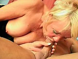 A blonde milf desperately craves a hard fucking.  She stris this guy out of his clothes and out of her own before dropping down to inhale his bone.  He delivers every inch of his cock inside the old slut until he erupts on her face.