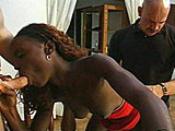 Mocha is a sexy ebony chick with a hot body.  Two white guys take her on while on the stairs.  She shows them her cock sucking abilities and lets them have their way with her fuck holes.  They both fuck her pussy at the same time, and then blow their loads in her mouth