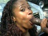 A cute black girl, Lona Laymen, shows off her sexy body as she washes this thug's car. She starts by swallowing his massive black dick before riding it deep in her tight snizz. He pulls out to smother her chin with goo.