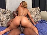 Sexy black babe, Sunshine, is getting fucked by a well huge black guy. She sure loves to smoke that pole! He pounds on her wet pussy in a bunch of different positions before dropping a cum bomb on her face.