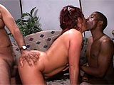 A black guy and a white guy take on this curvy, redheaded vixen who knows what shes doing with two dudes. She starts by blowing them both, but each excited guy gets a turn to glide in and out of her juicy snatch. She seems to like the black guy more, but she gets lots of enjoyment out of riding, 