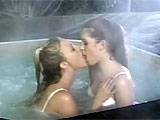 In this scene, two chicks are making out in a hottub.  They much each other's pussies and stuff toys in their twats.