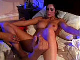 A hot big titty brunette, Tasha Hunter, is getting her cunt vigorously ravaged by a guy's tongue.   Once she good and wet, she hogs on the guy's cock before going for a ride on it.