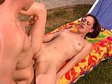 This sexy brunette slut takes a rest by the pool with her camera man after a long photoshoot at the beach.  The slut grabs hold of the guy's big johnson, and shoves it into her salivating mouth.  She gets it slicked up for her tender, bald pussy.