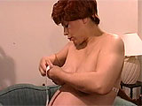 It's been a while since her first pregnancy, but this mature, Latina mom is handling her unexpected second bun in the oven pretty well. She had to stop shaving her twat because her stomach is so huge, and when she strips naked, you even see a few gray pubes. She takes her own measurements, chats a