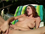 This scene features Jacynda.  She is outside for some fun in the sun and some quality alone time.  Jacynda jams her fingers in and out of her completely bald snatch to get herself off on this fine afternoon.