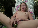 In this scene, Audrey Leigh rubs her muff outside in a lounge chair.  She puts herself over the edge with a vibrator that she shoves in and out of her hole.