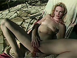 In this scene, Hannah Harper plays solo outside.  After she strips down, she finger fucks her vag, getting it wet and ready.  Hannah stuffs a double ended dildo ¾ deep to get herself off.