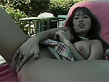 Fujiko Kano is a sex little Asian with big tits,  In this scene, she puts on little solo show for the camera.  While outside, she fingers herself, causing her pussy to cream all over her fingers for her to lick up.