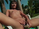 Freaky little Asian slut, Cheryl, has a hairy pussy and an enormous clit that she loves playing with. She wastes no time, pulling on her folds and pussy lips, then pushing two fingers way up in her slit, then busts out her dildo and jams it in too. She stretches her legs over, even using her feet to
